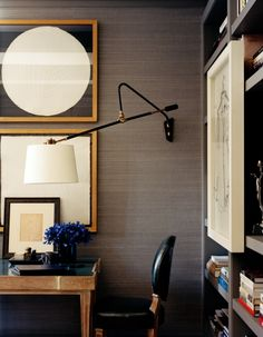 beatiful gold trim desk, swing arm lamp, with gray grasscloth. blue violets the perfect subtle accent.