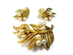 Vintage Designer Pearl Jewelry Set Brooch and Earrings Signed Trifari This Trifari set is textured gold tone with sprays of faux pearl berries.