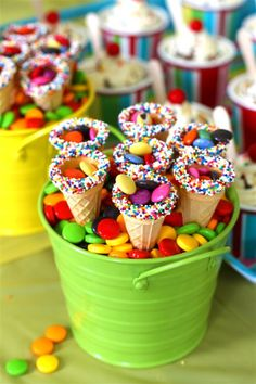 ice cream cone favors- made these cones by dipping the opening of the cone 1/2 way in a color melting wafers. then dip the rim with sprinkles.. filled the cone with color malted milk balls and wrapped in cello bags and tied bow around bag.