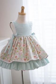 Summer blooms blue isabella dress Lovely blue floral fabric combined with a gingham in a vintage style pattern is the perfect little summer dress for [. Dresses Kids Girl, Little Dresses, Kids Outfits, Dress Girl, Easter Dresses For Girls, Little Girl Dress Patterns, Girls Dresses Sewing, Summer Dress Patterns, Dress Sewing