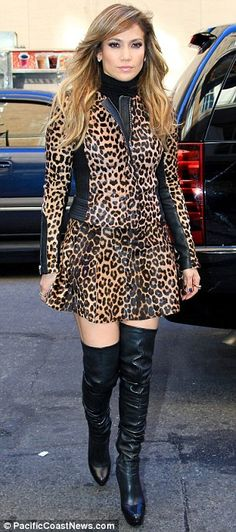Jennifer Lopez opted for a leopard-print skirt suit and thigh-high boots