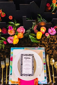 bright place setting mixed with black, photo by Vue Photography http://ruffledblog.com/pattern-play-wedding-inspiration #weddingideas #placesetting #reception