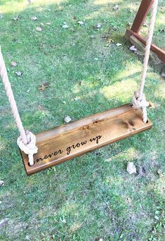 Never Grow Up Wooden Rope Swing Dark Wood Tree Swing Outdoor Wooden Swing Outdoor Kids Swing Outdoor Tree Swing Toddler Swing This Rectangle Tree Swing Is Made Of Polished Cedar Wood And Measures 24 Long X Wide X Swing Is Inscribed With Never Gro Outdoor Wooden Swing, Outdoor Trees, Wooden Swings, Outdoor Swings, Wooden Tree Swing, Outdoor Play, Backyard Swings, Outdoor Decorations, Wooden Swing Sets