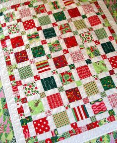 christmas quilt - maybe made using the christmas jammies/clothes the kiddos wore over the years?