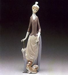 Retired: 1993  Woman w/Dog Lladró           Sell This Lladró            Spanish Name: Dama de Bulevar  Sculptor: Vincente Martinez  Last Retail: $260.00	Finish: Glazed  Year Issued: 1971	Height (in): 13.75  Year Retired: 1993	Width (in): N/A   Current (PERFECT) ($465)