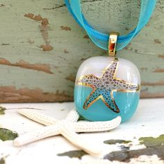 An image of a starfish is fused into turquoise and white background and accented with K gold The image is permanently bonded to the surface of glass It will not Fused Glass Jewelry, Fused Glass Art, Dichroic Glass, Glass Necklace, Resin Jewelry, Glass Pendants, Jewelry Art, Stained Glass, Jewlery