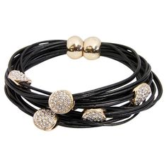 Layered magnetic string bracelet in black with circle charms.  Product: BraceletConstruction Material: Nickel-fr...