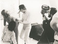 "Adrienne Corri  /  British actress  (November 13, 1930 - March 13, 2016)  On the set of ""A Clockwork Orange"", 1971.  L to R: Warren Clarke (kneeling), Adrienne Corri, Malcolm McDowell, director Stanley Kubrick."