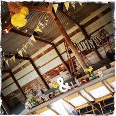 Rustic barn themed rehearsal dinner styled by Homestead Chic Event Stylists at Crazy Man's Hideaway in Veedersburg, IN