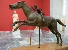 Greek bronze statue of a boy riding a horse. Found at Artemission-Euboea-Greece. Arcaeological Museum of Athens.
