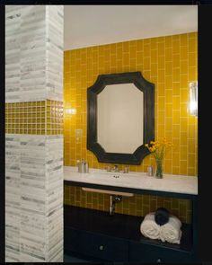 Yellow square tiles in a bathroom create a sunny/warm energy.