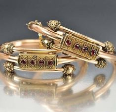 Rich Bohemian garnets dance across the front of this exquisite rare matched pair of Etruscan Victorian wedding bangle bracelets circa Each rose gold bangl Gold Bangles Design, Gold Earrings Designs, Gold Jewellery Design, Designer Bangles, Designer Wear, Antique Jewellery Online, Antique Jewelry, Vintage Jewelry, Antique Bracelets