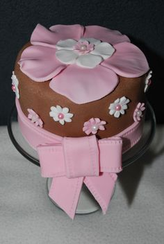 Cute little cake, filled with caramel & decorated with sugar paste...