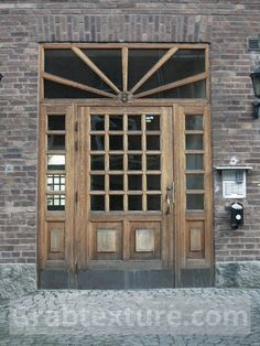 Beautiful old wooden door with glass windows is a royalty free photo that you can download at no cost. It is categorized as Doors. The original image packed in a zip-file and has the following dimensions (Width x Height): 3000 px x 4000 px. The file size is: