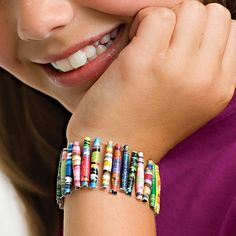 Magazine Bead Bracelet.  CASA made these with kids at the library this summer.  They're super easy and we found ourselves addicted to making them!