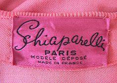 Happy Birthday to Elsa Schiaparelli. (Photo: Label inside a vintage garment in Schiaparelli's signature colour).