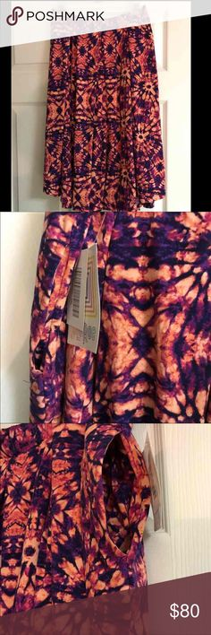 LuLaRoe 3x Madison Skirt tie dye/acid wash NWT Madison Skirt is so comfy with side pockets! In a very hard to find tie dye! Absolutely Adorable  Key words: cassette tape, tie dye, acid wash, Aztec. Black, unicorn, hipster cat, hipster lion, paws, animal lover, cat, dog, watercolor, mermaid, Disney LuLaRoe Skirts Midi