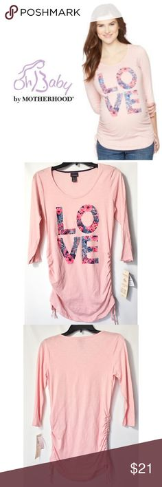 """Oh Baby by Motherhood Graphic Maternity Tee Adorable  ❤️ Love ( Pinks & Blues) graphic on this cute tee by Oh Baby. Ruched side with adjustable drawstring for a comfortable fit. 3/4 Sleeve. Cotton/Polyester. Oh baby size chart: S (4-6) chest 36-37"""". M (8-10) chest 38-39"""". Please order pre-pregnancy size. Brand new with tags. Oh Baby by Motherhood Tops Tees - Long Sleeve"""