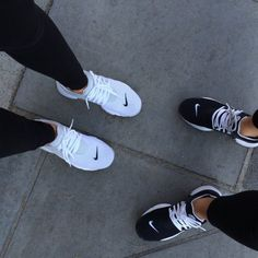 Wheretoget - Nike white sneakers and Nike black sneakers