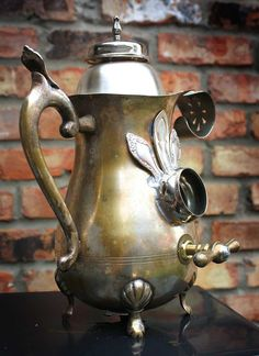 steam punk (?) upcycling  (Take care - birds or fledglings may cook in metal bird houses when the weather's hot!)