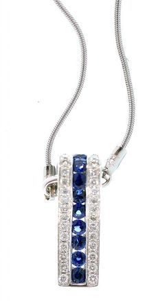 A SAPPHIRE AND DIAMOND WEDGE SHAPED PENDANT, WITH A CENTRAL 'STRIPE' OF SAPPHIRES, FLANKED BY EVENLY SIZED DIAMONDS IN 18CT WHITE GOLD, ON 18CT WHITE GOLD FINE ROPE NECKLET, 8G  Sold @ Mellors & Kirk