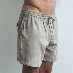 Made from soft organic linen and featuring a drawstring waistband, they're our favourite, breathable and versatile wardrobe staple. Perfect shorts for every occasion.  Dark Sand Relaxed fit  Drawstring waistband   Single pocket at the back 100% Linen  Cool wash, hang dry  Model wears size XL / 36 inch waist Linen Shorts, Wardrobe Staples, Label, Organic, Pocket, Dark, Fit, How To Wear, Collection
