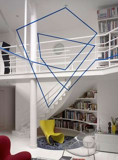 Swiss artist Felice Varini has been creating illusions of flat graphics superimposed on three dimensional spaces since 1979 using the same eye-deceiving technique called anamorphosis. The complete shapes can only be seen when viewed at certain angles, otherwise the viewer will only see some random broken pieces.