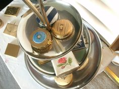 Using a vintage cake stand to display my vintage powder compacts