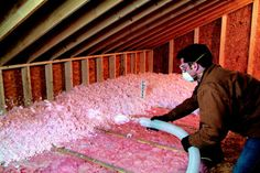 Loosefill Insulation being installed over existing attic insulation, increasing Attic R-Value from R-19 to R-44.