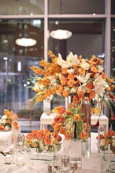 modern wedding centerpiece with orange tulips
