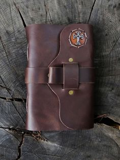 Our Prayer Journal in Dark Chocolate leather!  Unique features include a 1.25 inch wide strap & integrated pen loop closure along with an inset riveted steel Celtic Cross.
