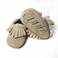 Be the hit of the baby shower with these beautiful and personalized suede baby moccasins! Made to order for your little ones! Perfectly-designed with elastic (easy to get on, but hard for baby to kick off), and high quality permanent decals pressed by hand. These soft sole suede moccasins are meticulously created with your sweet ones toes in mind!  Order now by these 4 simple steps- Choose your moccasin color, choose monogram style and color; finally choose shoe size! Please be sure to…