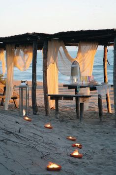 Nice idea for beach party, like the candles, curtains and table, etc.