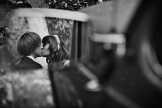 temescal canyon park pacific palisades bride and groom kiss in car mirror reflection. - Jesse Mergenthaler