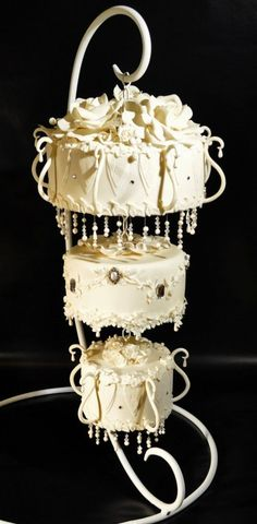 Put a twist on a traditional tiered wedding cake with this suspended chandelier cake.