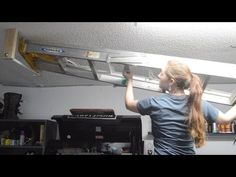 If you have a ladder that is taking up space, here is a simple project that will allow you to hang it from the ceiling. I have a full written tutorial posted. Garage Hanging Storage, Garage Ceiling Storage, Hanging Ladder, Ladder Storage, Garage Tool Storage, Diy Ladder, Garage Organization, Ladder Racks, Garage Shelving