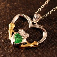 Our Emerald Claddagh Heart necklace is truly the heart of Ireland. Nothing expresses enduring love like a Claddagh heart. The Claddagh has become the universal symbol of love, loyalty and friendship. Do you have someone in your life to which you pledge your love, loyalty and friendship forever? Give her your heart, your Irish heart today.