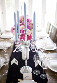 silver candelabra and light blue candles