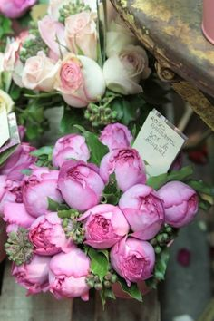 French flower market:  picking up a bouquet on the way home after Sunday morning café au lait at the local café.