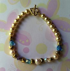 GrandMother's Bracelet  Made with 6mm Almond color Pearls, Czech crystals, Fresh water white Pearls & Gold heart accents. Sold