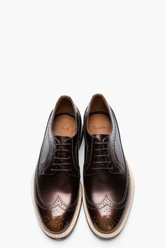 Wow I seriously LOVE these...PAUL SMITH Metallic Bronze Longwing Brogues....with a neat camouflage sole they are both classic and edgy with a modern twist