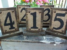 Rustic Table Numbers with Burlap and Vintage/Antiqued look wood Brown : wedding aged beach burlap black blue brown gold green ivory orange reception reception decor red shabby chic table numbers wedding guest organization white Il 259667353 Burlap Table Numbers, Wedding Table Numbers, Table Wedding, Burlap Table Cloths, Burlap Wedding Signs, Wedding Reception, Burlap Projects, Burlap Crafts, Diy Projects