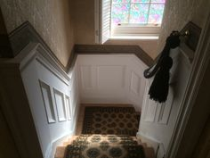 beaded wall panelling with fancy detailing on landing and going down stairs