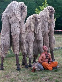 Strange things can happen. (crickets) and I thought Americans are weird lol Humano scarecrows! Keep ppl away Charles Freger, Stilt Costume, Fluffy Cows, Wooly Bully, Bizarre News, Creature Design, Tribal Art, Mythical Creatures, Larp