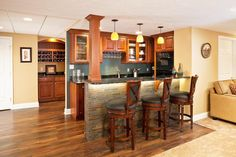 Interesting Small Basement Bar Design Interior With Wooden Floor and Unique Lamps and Cream Wall Paint Color