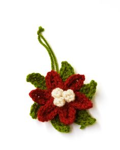 Poinsettia Ornament ~ Instead of an ornament, I am going to put a pin on the back and give to my friends as a little Christmas gift or a gift tag.  pattern from Lion Brad Yarn.