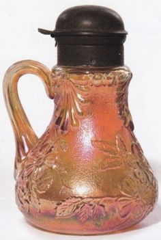 Carnival Glass; Unattributed, Wild Rose, Syrup Pitcher, Marigold, 6 inch. C. 1901 -1950