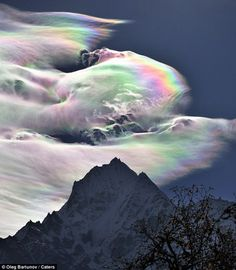 An Iridescent (Rainbow) Cloud in Himalaya The phenomenon was observed early morning on October 18, 2009 on the path to Khumjung in the Himalayas. The mountain pictured is Thamserku. We get clouds like that here (WA state) on occasion.