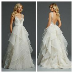This frothy, tiered wedding gown with an open back is stunning!