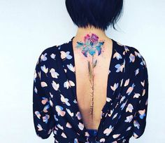 Flower tattoo by Pissaro Tattoo